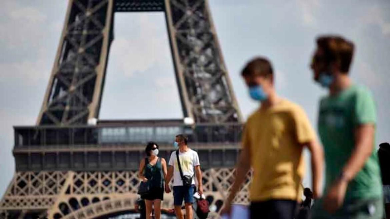 parisi -gallia - pyrgos aifel - eiffel tower - maskes - touristes ΦΩΤΟΓΡΑΦΙΑ ΑΠΕ ΜΠΕ 16-07-2021